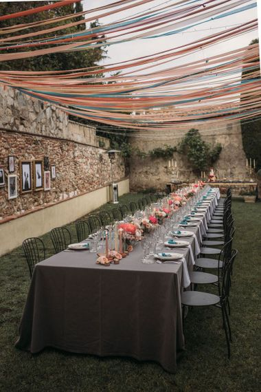 Long Wedding Reception Table with Ribbon Canopy and Floral Table Decor
