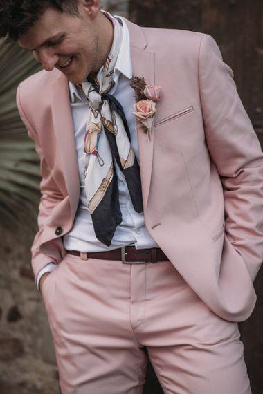 Groom in Blush Pink Wedding Suit with Neck Tie