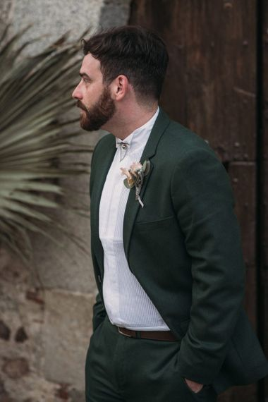 Groom in Forest Green Wedding Suit and Grandad Shirt