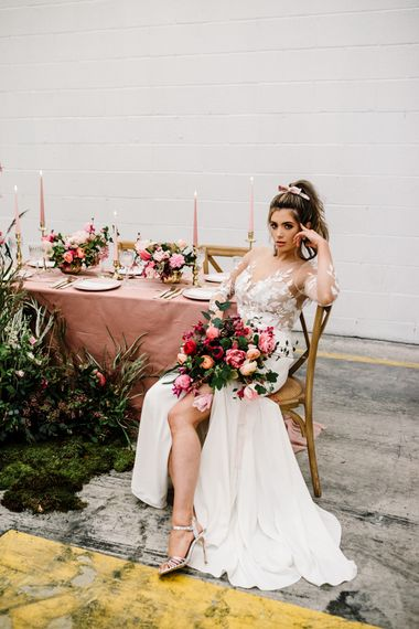 Bride in Illusion Lace Bodice Wedding Dress Holding a Deep Pink and Green Wedding Bouquet