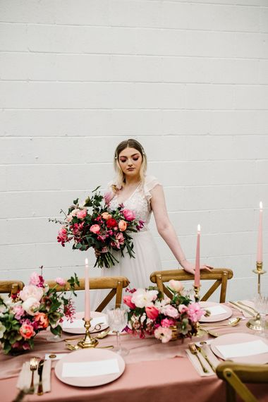 Beautiful Bride holding an Oversized Deep Pink and Green Wedding Bouquet