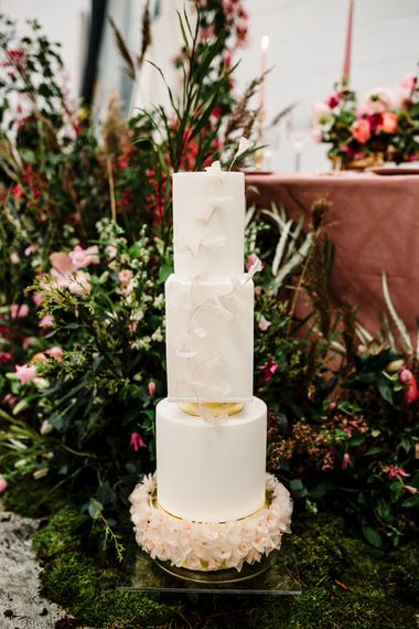 Tall Wedding Cake with Floral Skirt and Front Decor