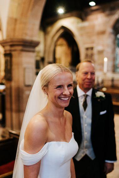 Bride smiles at someone off-camera