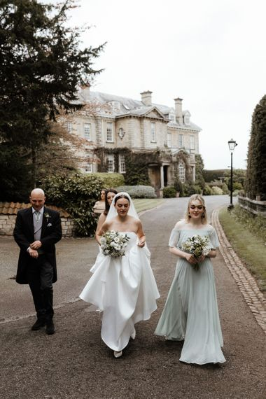 Bridal Party Make Their Way To The Church Ceremony