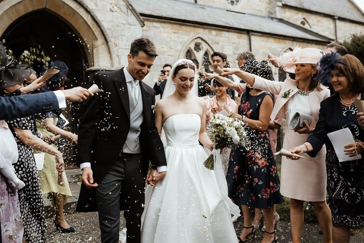 Confetti Exit For Bride In Strapless Wedding Dress And Groom  In Tail Suit