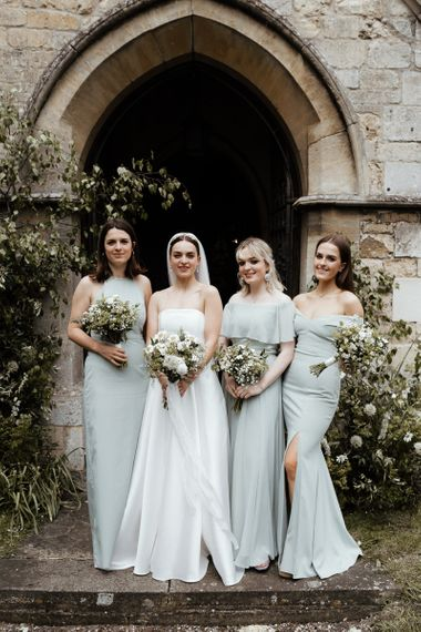 Bride in Strapless Halfpenny London Wedding Dress And Blues Green Bridesmaid Dresses