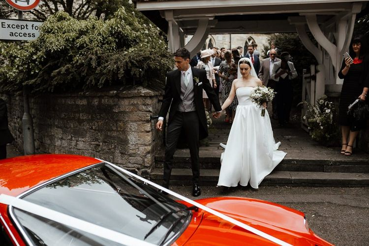 Bride and Groom Make Their Way To Wedding Transport