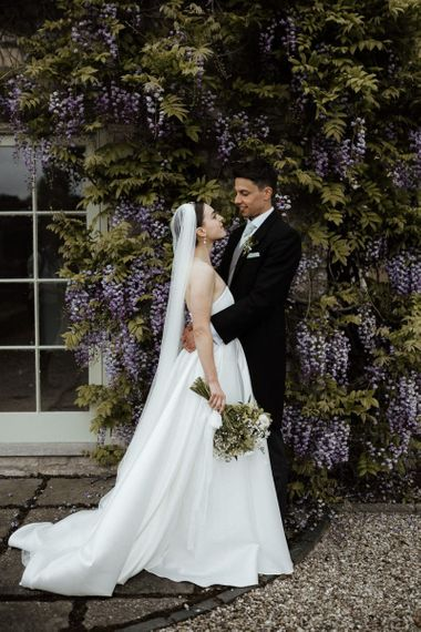 Bride In Strapless Wedding Dress With Bouquet And Veil
