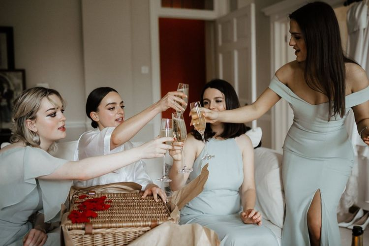 Bridesmaids Getting Ready And Toasting The Day