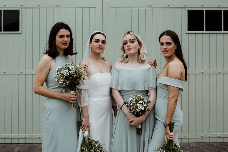 Bride In Strapless Wedding Dress With Blue Bridesmaid Dresses
