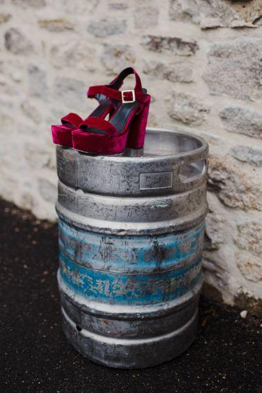 Red Suede Platform Shoes on a Tin Barrel