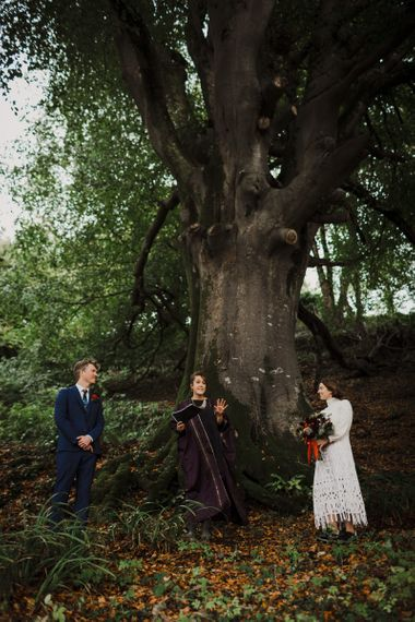 Bride and Groom Saying Their Vows Under a Tree