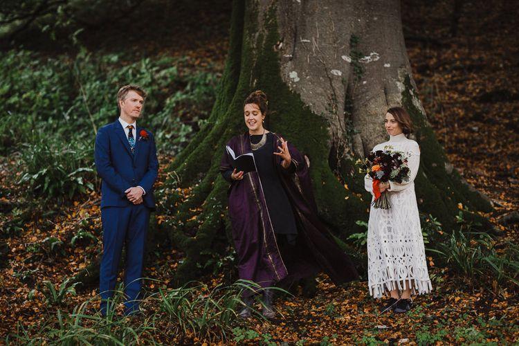 Boho Bride in Crochet Wedding Dress and Woollen Jumper and Groom in Navy Blue Suit Getting Married