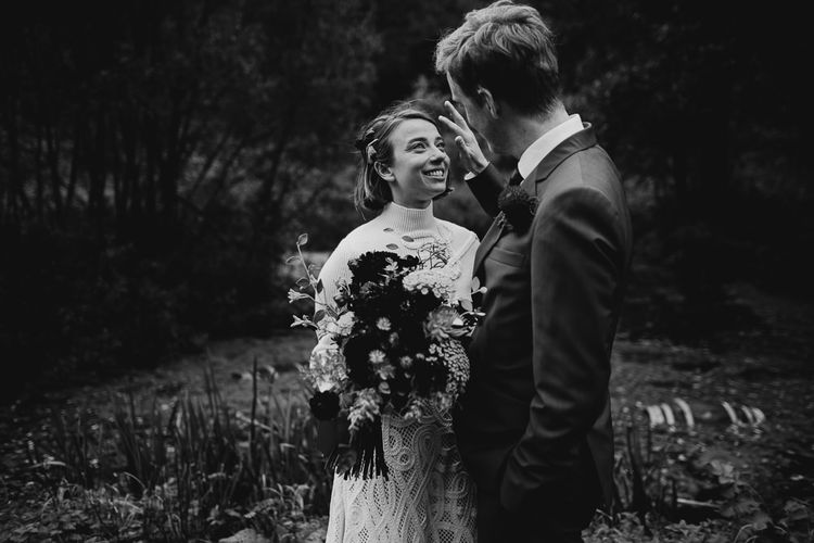 Black and White Portrait of  Bride in Crochet Wedding Dress and Woollen Jumper and Groom in Navy Suit