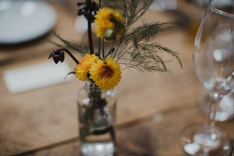 Yellow Dahlia's in a Glass Bottle as Centrepieces
