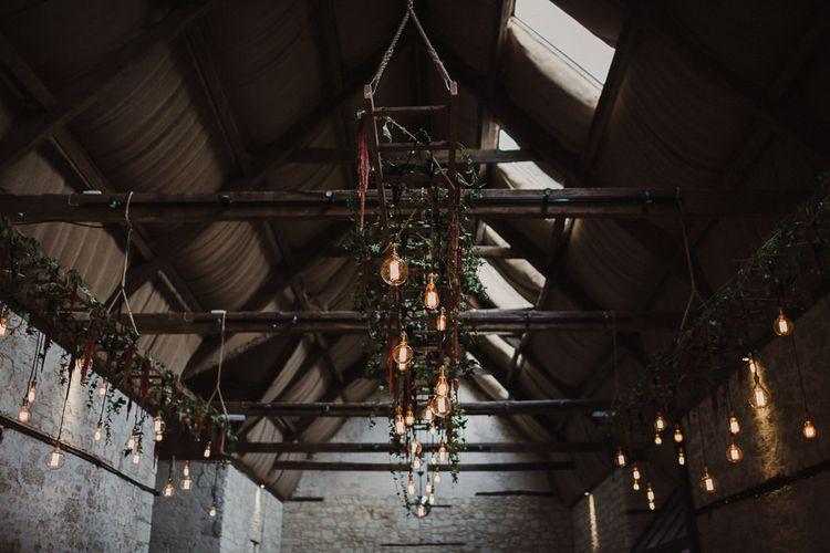 Industrial Hanging Edison Bulb Installation with Foliage Decor
