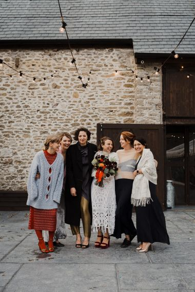Bride in Crochet Wedding Dress and Woollen Jumper Posing with her Best Friends