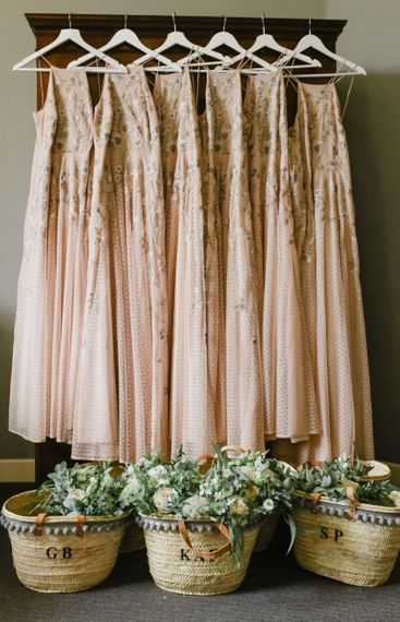 Pink bridesmaids dresses with embroidery detail