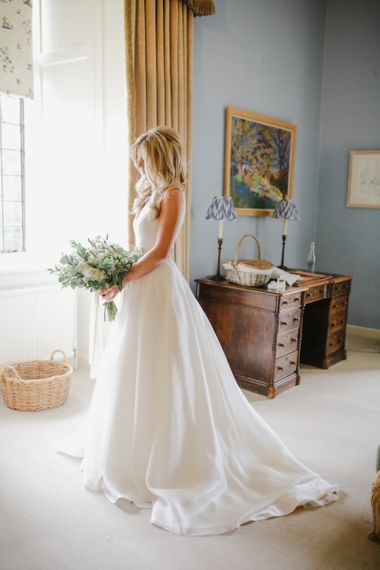 Bride on wedding morning in Sassi Holdford wedding dress