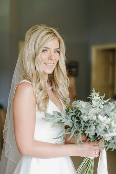 Natural bridal hair and makeup with long blonde hair