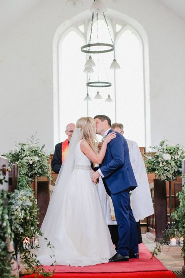 You may now kiss the bride moment at church wedding ceremony