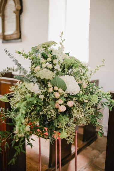 Green, white and pink church wedding flower arrangement