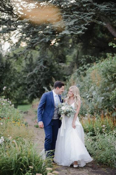 Bride and groom portrait in the gardens at Askham Hall