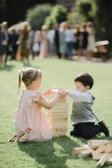 small wedding guests playing garden games