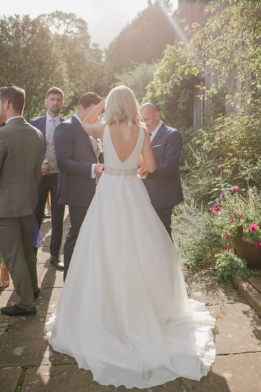 Bride in Sassi Holford wedding dress and belt