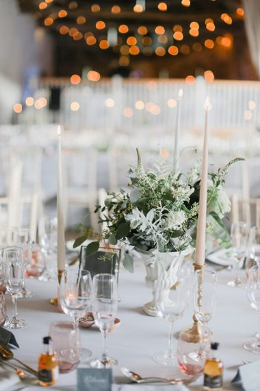 Romantic table centrepiece decor with flowers and taper candles