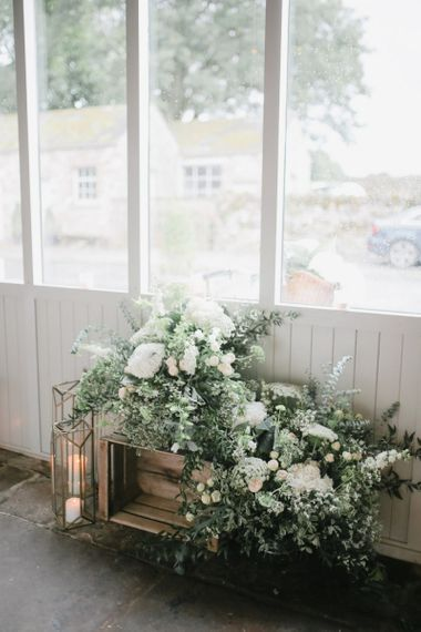 Rustic crate, lantern and flower wedding decor at Askham Hall