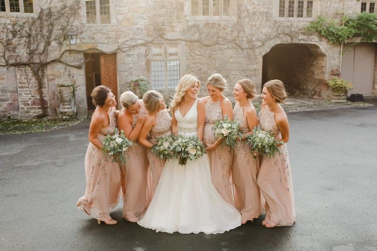 bridal party portrait at Askham Hall with bridesmaids in pink dresses