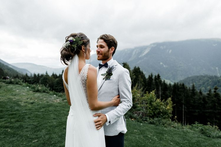Bride in Mariées Passion Wedding Dress and Groom in Grey Blazer