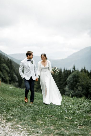 Bride in Mariées Passion Wedding Dress and Groom in Grey Blazer and Navy Chinos