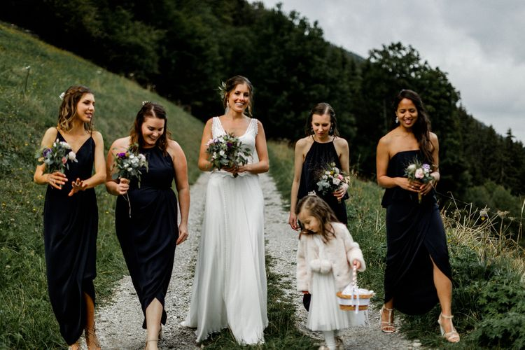 Bridal Party Picture in the French Alps with Bride in Mariées Passion Wedding Dress and Bridesmaids in Navy Dresses