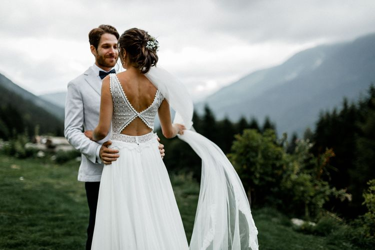 Bride in Backless Mariées Passion Wedding Dress and Groom in Grey Blazer and Navy Chinos