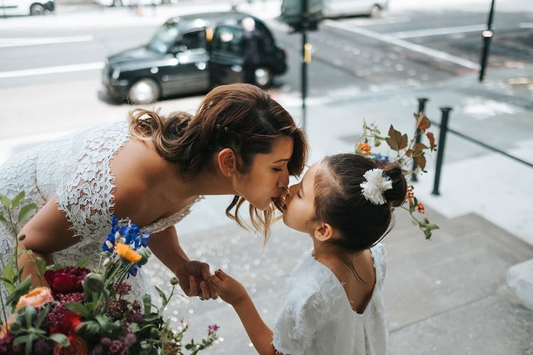 Bride in Lace Whistles Wedding Dress with High/Low Hem and Bardot Neckline | Flower Girl in White Zara Dress with Short Sleeves and Scoop Back | Wedding Bouquets with Bright Wild Flowers | High Street Wedding Dress for an Intimate Crouch End Pub Wedding with Bright Flowers | Miss Gen Photography