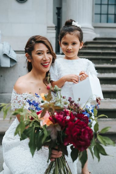 Bride in Lace Whistles Wedding Dress with High/Low Hem and Bardot Neckline | Flower Girl in White Zara Dress with Short Sleeves and Scoop Back | Bridal Bouquet with Bright Wild Flowers | High Street Wedding Dress for an Intimate Crouch End Pub Wedding with Bright Flowers | Miss Gen Photography
