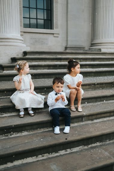 Flower Girl in White Zara Dress with Short Sleeves and Scoop Back | Page Boy in Zara Shirt, Trousers and Bow Tie | Wedding Ceremony at Old Marylebone Town Hall | High Street Wedding Dress for an Intimate Crouch End Pub Wedding with Bright Flowers | Miss Gen Photography