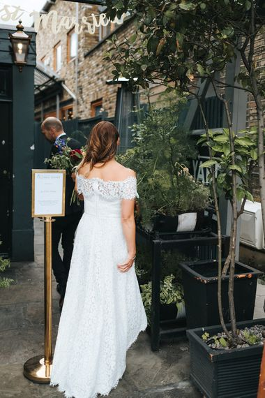 Bride in Lace Whistles Wedding Dress with High/Low Hem and Bardot Neckline | Groom in Black Reiss Jacket and Black Nudie Jeans with Church's Shoes | Bridal Bouquet with Bright Wild Flowers | Victoria Stakes Pub Wedding Reception | High Street Wedding Dress for an Intimate Crouch End Pub Wedding with Bright Flowers | Miss Gen Photography