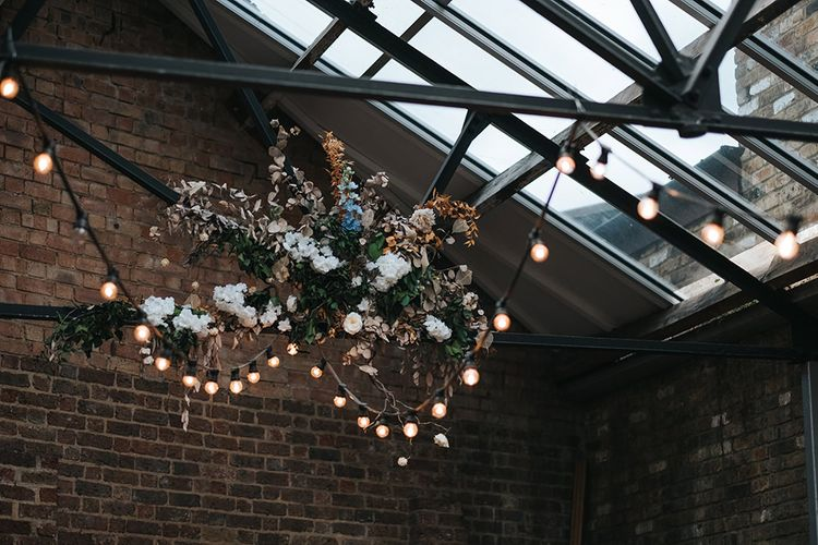 Floral Decor Hanging from Ceiling | Festoon Lights | Victoria Stakes Pub Wedding Reception | High Street Wedding Dress for an Intimate Crouch End Pub Wedding with Bright Flowers | Miss Gen Photography