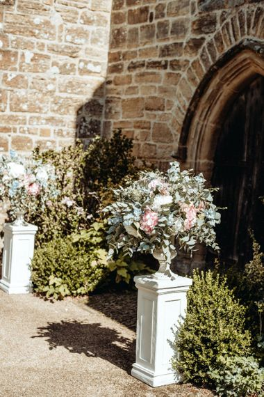 Pastel Church Floral Arrangements | Classic Country Wedding at Wadhurst Castle, East Sussex with Wedding Suppliers from RMW. The List | Foto Memories Photography