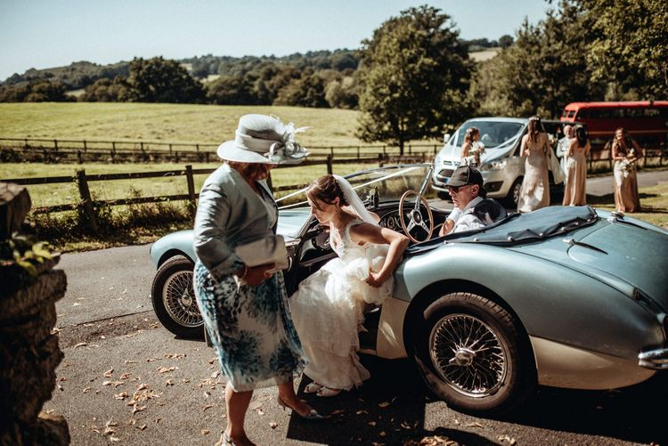 Bridal Entrance Classic Blue Car | Bride in Lace Pronovias Wedding Dress | Classic Country Wedding at Wadhurst Castle, East Sussex with Wedding Suppliers from RMW. The List | Foto Memories Photography