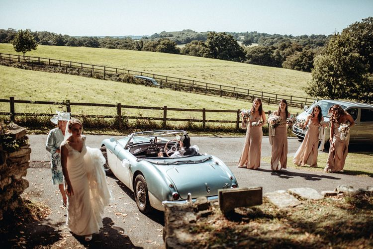 Bridal Entrance Classic Blue Car | Bride in Lace Pronovias Wedding Dress | Bridesmaids in Pink Debenhams Dresses | Classic Country Wedding at Wadhurst Castle, East Sussex with Wedding Suppliers from RMW. The List | Foto Memories Photography