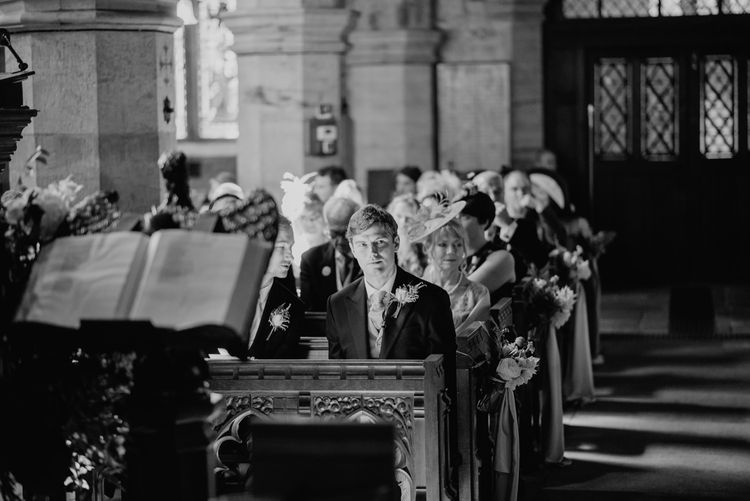 Groom at the Church Altar in Traditional Morning Suit by Macinnes Bespoke Tailoring  | Classic Country Wedding at Wadhurst Castle, East Sussex with Wedding Suppliers from RMW. The List | Foto Memories Photography