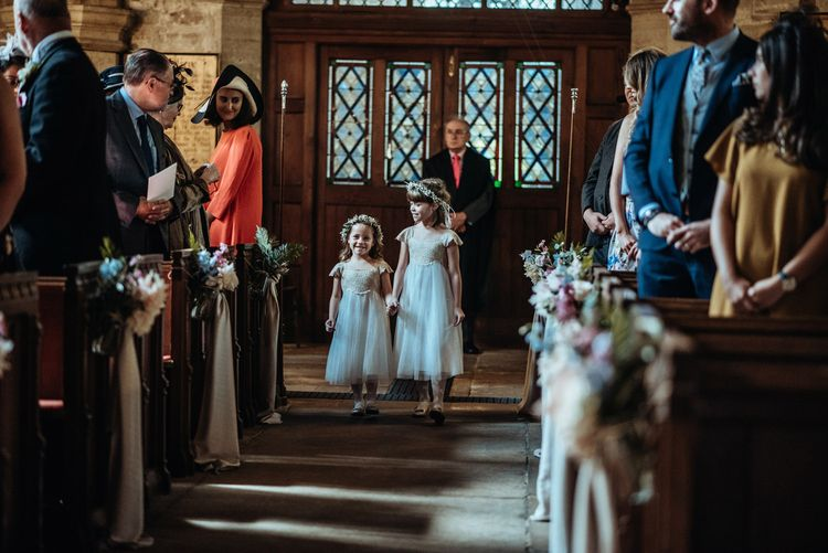 Flower Girl Church Entrance in Monsoon Dresses & Flower Crowns | Classic Country Wedding at Wadhurst Castle, East Sussex with Wedding Suppliers from RMW. The List | Foto Memories Photography