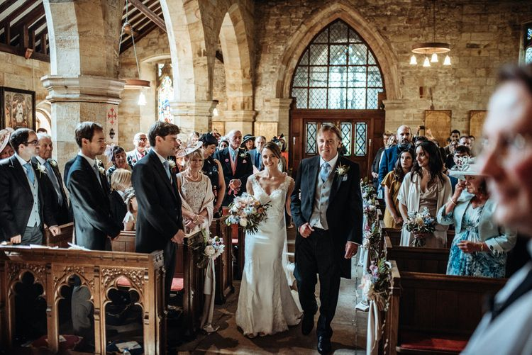 Church Bridal Entrance in Bride in Lace Pronovias Wedding Dress | Classic Country Wedding at Wadhurst Castle, East Sussex with Wedding Suppliers from RMW. The List | Foto Memories Photography