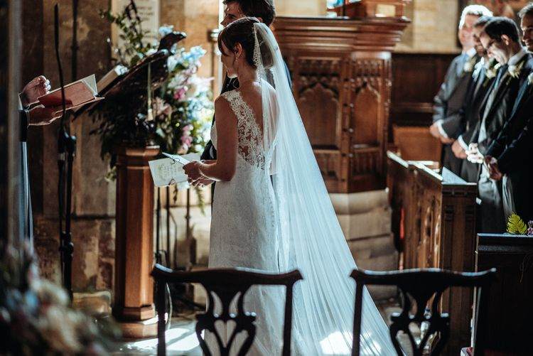 Church Wedding Ceremony | Bride in Lace Pronovias Wedding Dress | Groom in Traditional Morning Suit by Macinnes Bespoke Tailoring | Classic Country Wedding at Wadhurst Castle, East Sussex with Wedding Suppliers from RMW. The List | Foto Memories Photography