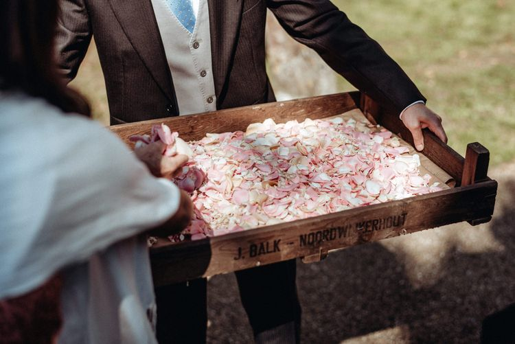 Rustic Crate Full of Pink Wedding Confetti | Classic Country Wedding at Wadhurst Castle, East Sussex with Wedding Suppliers from RMW. The List | Foto Memories Photography