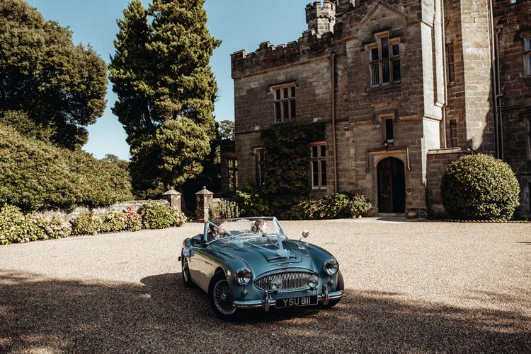 Vintage Blue Wedding Car | Bride in Lace Pronovias Wedding Dress | Groom in Traditional Morning Suit by Macinnes Bespoke Tailoring | Classic Country Wedding at Wadhurst Castle, East Sussex with Wedding Suppliers from RMW. The List | Foto Memories Photography